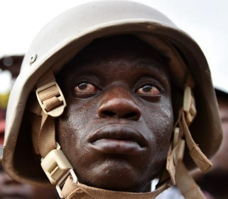 A Burkinabe soldier - caught in the middle of a project he does not understand as his bosses fight over the spoils. His bloodshot and bewildered eyes say it all.