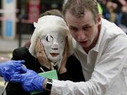 Helping a victim - the picture that said it all - London unbowed