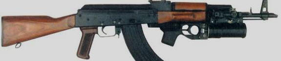 This is a type of the under barrel grenade firing AK-47 rifle. A war weapon not normally used in police crowd control.