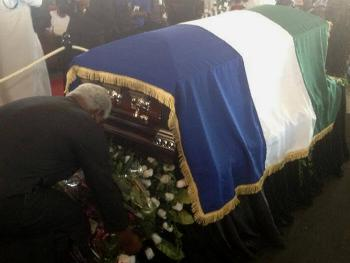 President Koroma stoops to lay a wreath in honour of the late President Ahmad Tejan Kabbah.