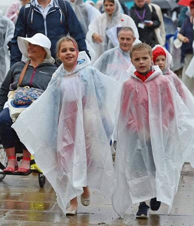 The rain could not stop these revellers.
