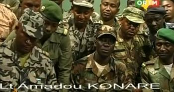 Malian soldiers on television announcing the overthrow of President Toumani