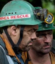 The look of despair on the faces of two rescuers
