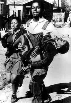 The iconic picture. A school boy shot and killed by South African security forces.