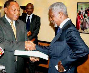 Justice Waki (left) hands a copy of the report to Kofi Annan